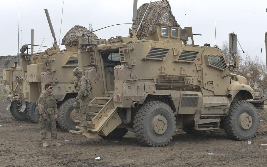 Soldiers of Apache Company, 1st Battalion, 26th Infantry Regiment dismount a Mine Resistant Ambush Protected vehicle after a reconnaissance mission on Wednesday, Dec. 28, 2016. The men of Apache Company are advising local police and providing security on a tactical base near the front lines in the campaign to push Islamic State from Mosul, Iraq.