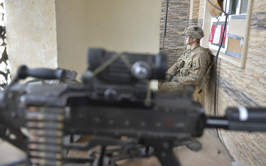 Spc. John Rhodes of Myrtle Point, Ore., is pictured here on Wednesday, Dec. 28, 2016, serving watch duty at a safe house near the forward line of troops in the battle for Mosul, Iraq. Rhodes is one of the soldiers of Apache Company, 1st Battalion, 26th Infantry Regiment, helping secure a tactical base where coalition forces assemble.