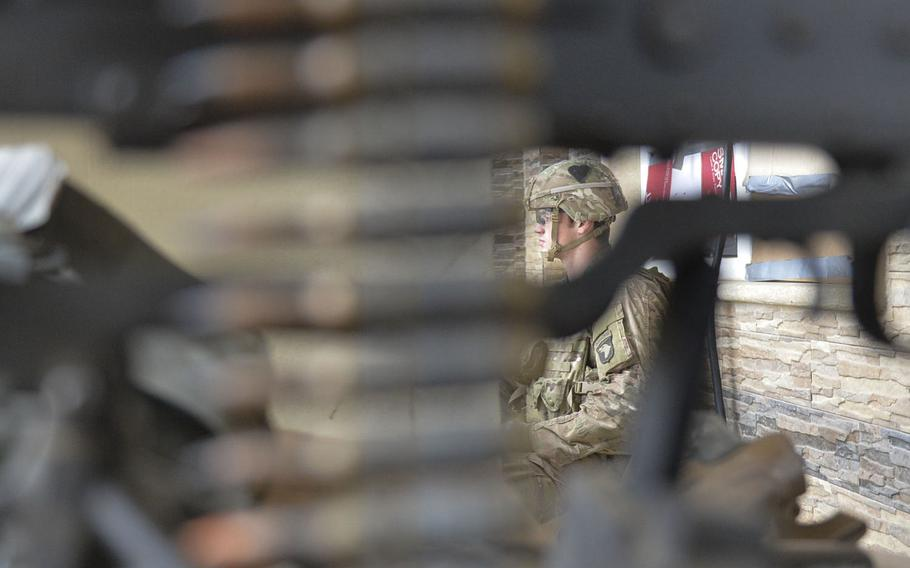Spc. John Rhodes of Myrtle Point, Ore., is pictured Wednesday, Dec. 28, 2016, serving watch duty at a safe house near the forward line of troops in the battle for Mosul, Iraq. Rhodes is one of the soldiers of Apache Company, 1st Battalion, 26th Infantry Regiment helping secure a tactical base where coalition forces assemble.