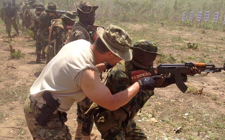 A California National Guard Special Forces soldier trains with a Nigerian soldier in Nigeria in June 2014. The Nigerian soldiers are being trained to counter Boko Haram.