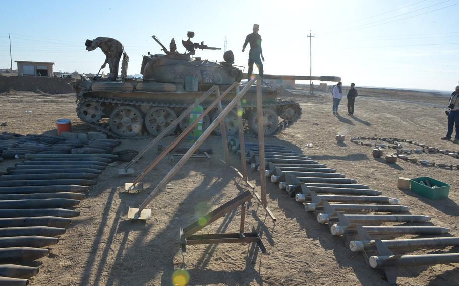 Pictured here near an Iraqi army tactical base near Karamlis, outside Mosul, Iraq, on Nov. 19, 2016, is a cache of rockets and launchers produced by the Islamic State group, which has used sophisticated manufacturing processes to make its munitions. The weapons were recovered on the battlefield, as was the T-55 tank in the background.