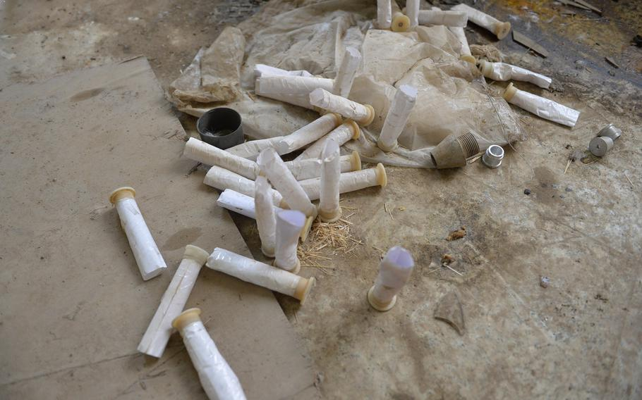 These 12-gauge primers, pictured here on the floor of a church building in Qaraqosh, Iraq, near Mosul, appear to have been modified by Islamic State munitions makers for use as mortar ignition charges, pictured on Dec. 17, 2016. Researchers believe the militants may have produced tens of thousands of rockets and mortars using sophisticated industrial processes.