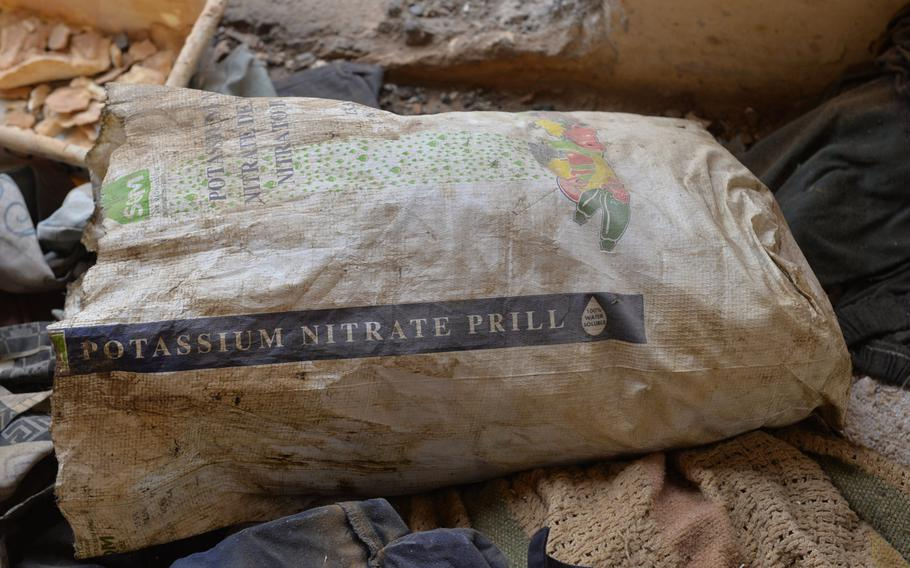A bag of potassium nitrate, a precursor in producing rocket propellant, is pictured here among blankets in a building at St. George's Church in Qaraqosh, Iraq, Dec. 17, 2016. The church building was used to manufacture munitions.