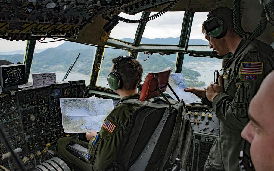 C-130H navigators from the 36th Airlift Squadron at Yokota Air Base, Japan, confirm the flight path over Shikoku Prefecture during Keen Sword drills in November.