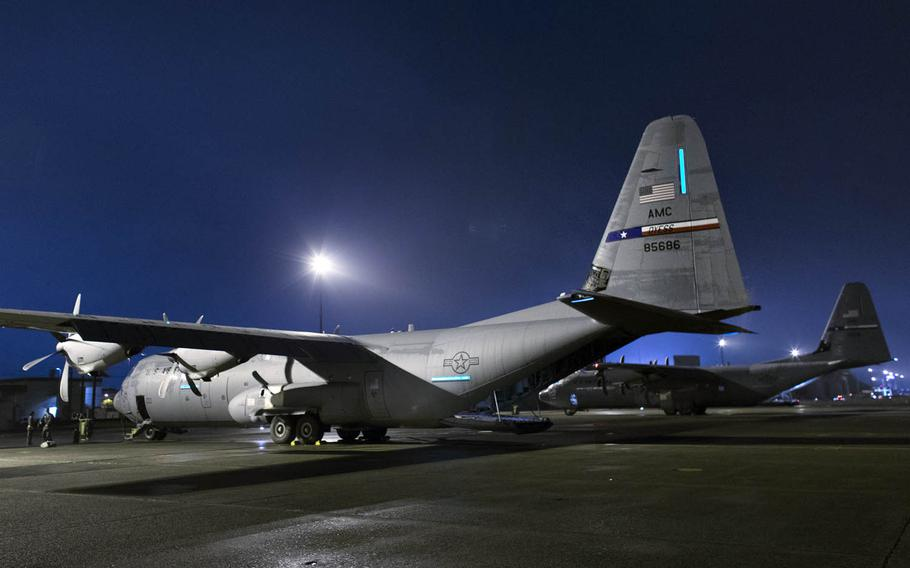 C-130J Super Hercules cargo planes sit at Yokota Air Base, Japan, in July. Three of the aircraft from Dyess Air Force Base, Texas, traveled to Yokota to aid in the transition from the C-130 Hercules to the J model.