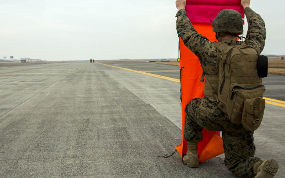 Marines establish an expeditionary airfield during aircraft landing zone training at Marine Corps Air Station Iwakuni, Japan, in late December.