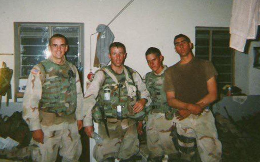 From left, 1st Lt. Dana Krull, Sgt. 1st Class Eric Geressy, Sgt. Vincent Garza and Sgt. Brock Lucas in Sinjar, Iraq, 2003. Geressy, a retired Army sergeant major, went to Mosul as a platoon sergeant when the city was under the control of the 101st Airborne Division, commanded by then-Maj. Gen. David Petraeus, in October 2003.