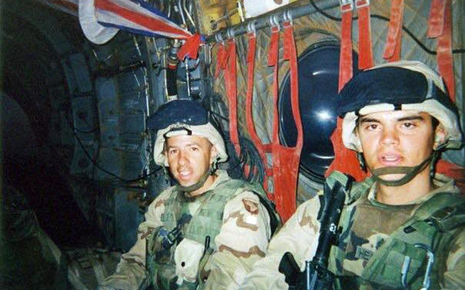 Sgt. 1st Class Eric Geressy and Staff Sgt. Scott Heaward air assault from Baghdad to Sinjar, Iraq, in 2003. Geressy, a retired Army sergeant major, went to Mosul as a platoon sergeant when the city was under the control of the 101st Airborne Division, commanded by then Maj. Gen. David Petraeus, in October 2003.