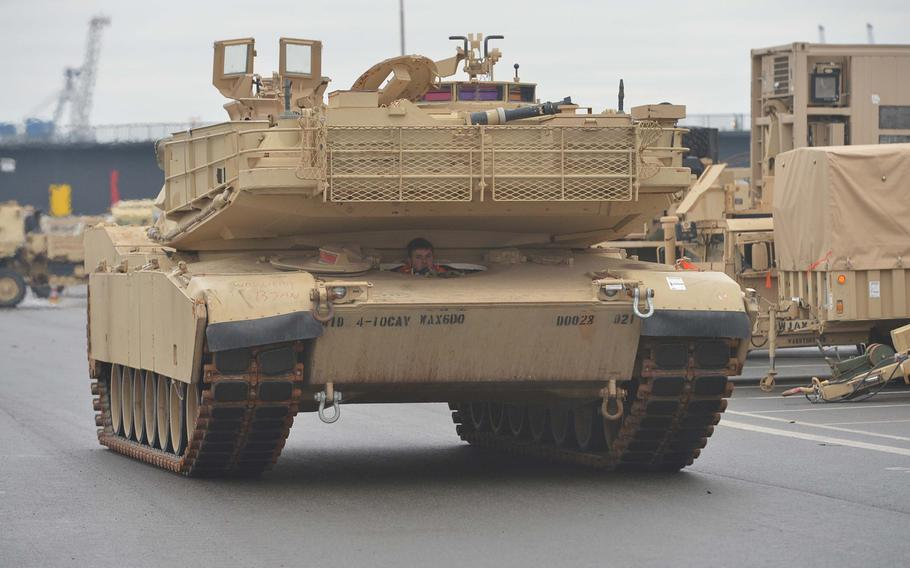 An M1A1 Abrams tank rolls through the port of Bremerhaven, Germany, after being unloaded from a ship, Sunday, Jan. 8, 2017. The 3rd Armored Brigade Combat Team, 4th Infantry Division, out of Fort Carson, Col., is headed for Poland for a nine-month rotation as part of Operation Atlantic Resolve.