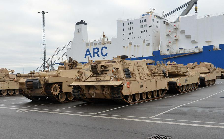 Armor belonging to 3rd Armored Brigade Combat Team, 4th Infantry Division, out of Fort Carson, Col., sits in the port of Bremerhaven, Germany, after being unloaded from a ship, on Sunday, Jan. 8, 2017. The ABCT's equipment and personnel are headed to Poland for a nine-month rotation.