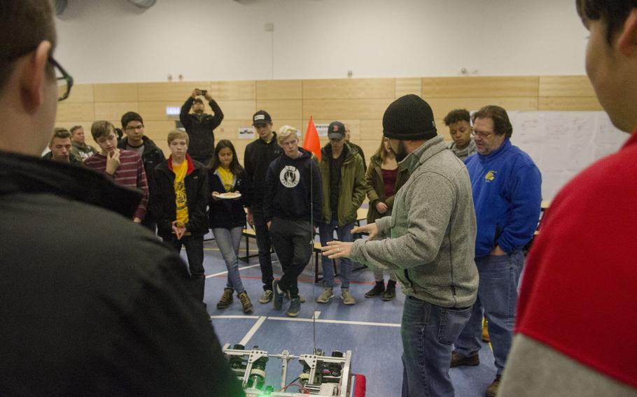 Brian Barnes, a teacher at the DODEA Virtual High School and mentor to the Wiesbaden High School RoboWarriors robotics club, describes the drive train of the robot which will be used in this year's FIRST Robotics Competition during the team's season kickoff party, Saturday, Jan. 7, 2017, in Wiesbaden.