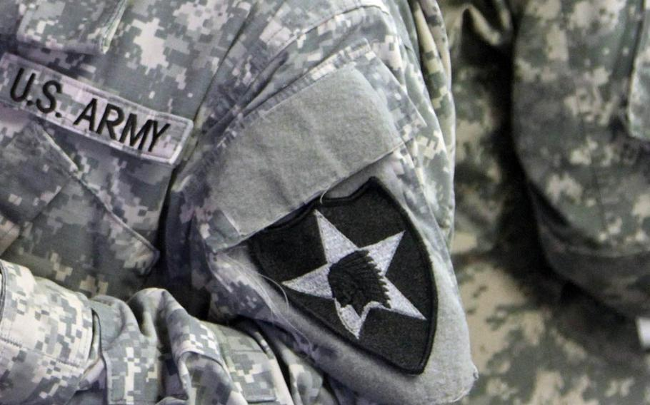 Two 2nd Infantry Division soldiers in South Korea have been indicted in connection with a $10 million methamphetamine smuggling case involving the U.S. military postal service, officials said Wednesday, Jan. 11, 2017.