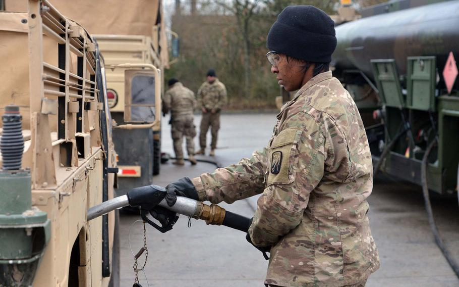 Staff Sgt. Priscella Gray of the Baumholder, Germany-based 515th Transportation Company fuels up a Humvee that had convoyed from Bremerhaven, Monday, Jan. 9, 2017. On the way to Poland, the convoy ended its first day at a training area near Belsen, Germany.