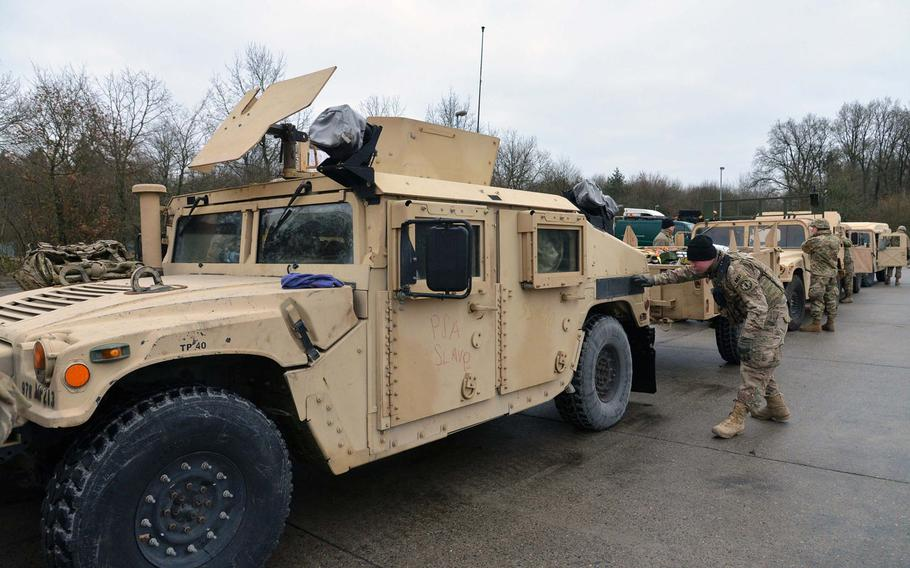 Military policemen check out their Humvees after arriving at a training area near Belsen, Germany, on their way to Poland from Bremerhaven, Germany, Monday, Jan. 9, 2017.