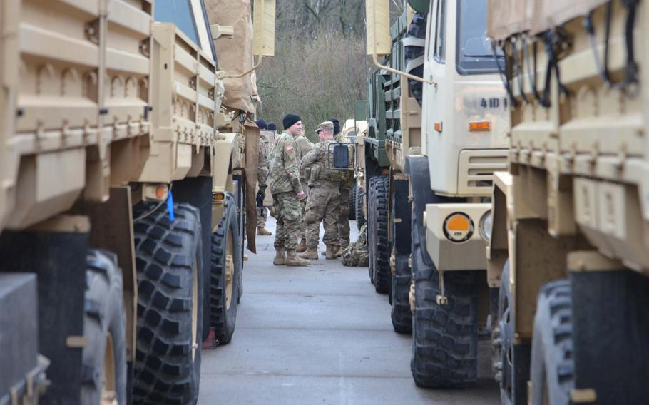 Soldiers talk after arriving at a training area near Bergen, Germany, after convoying from Bremerhaven on their way to Poland as part of Operation Atlantic Resolve, Monday, Jan. 9, 2017.