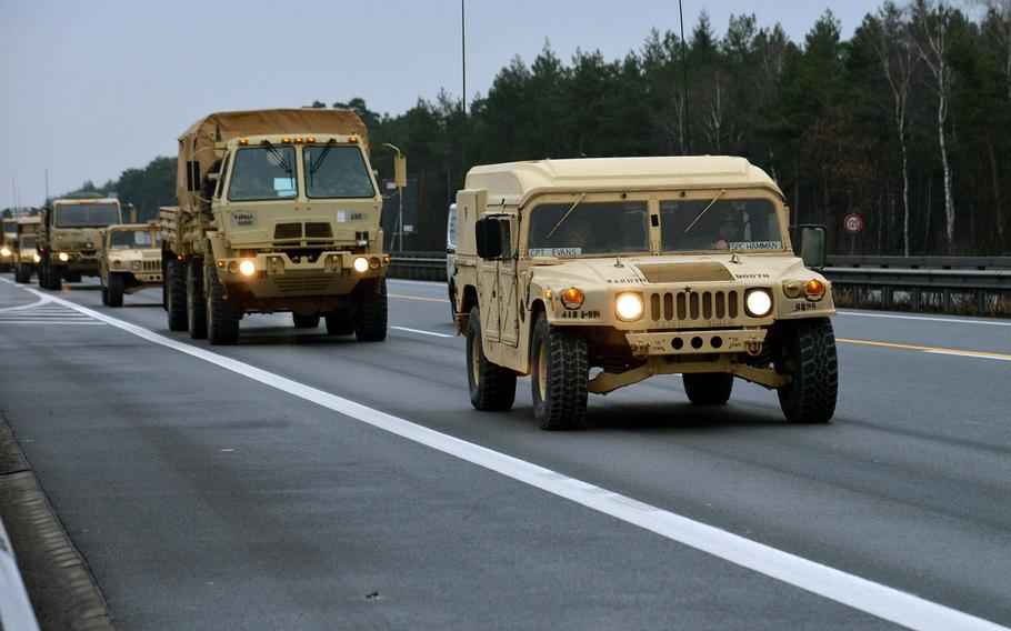 A convoy of vehicles of the 3rd Armored Brigade Combat Team, 4th Infantry Division drives along Autobahn A7 near Hannover, Germany, Tuesday, Jan. 10, 2017, on the way to Poland.