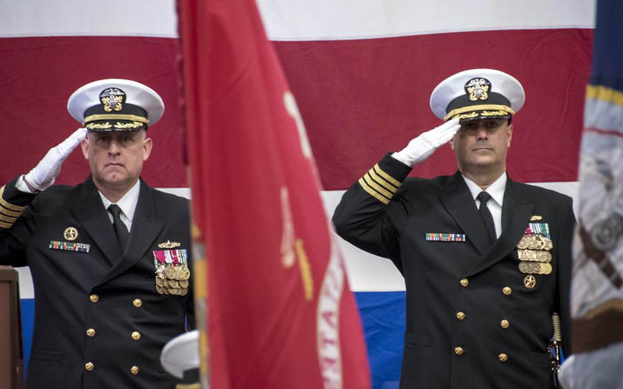 Capt. George Doyon, right, relieved Capt. Marvin Thompson, left, as commander of Amphibious Squadron 11 during a change-of-command ceremony aboard the USS Bonhomme Richard in Sasebo, Japan, Monday, Jan. 9, 2017.