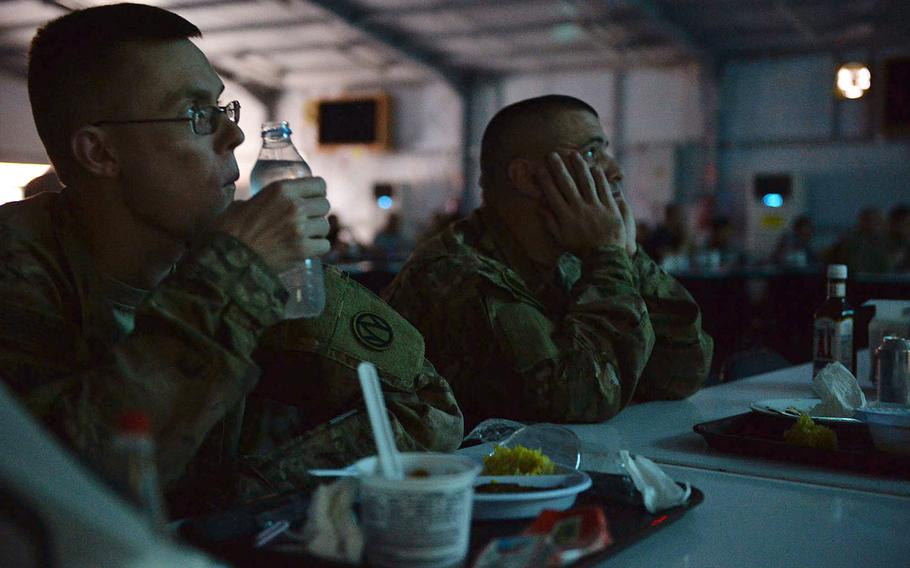 Staff Sgt. Jonathan Broyles, left, and Staff Sgt. Brandon Lund watch ''Rogue One: A Star Wars Story'' during a special screening for U.S. and coalition troops at Irbil International Airport in Iraq on  Jan. 6, 2017. Troops said the showing breaks up the monotony of life on deployment and gives them a chance to talk about something other than work with family back home.