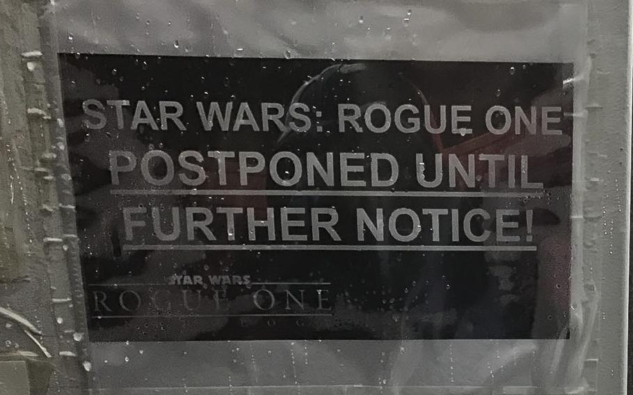 A sign at the dining facility on a coalition base at Irbil International Airport, pictured here on Sunday, Dec. 25, 2016, informs servicemembers that special showings of the latest ''Star Wars'' film, ''Rogue One,'' would be postponed indefinitely. Operational and weather conditions delayed the screening in Irbil.
