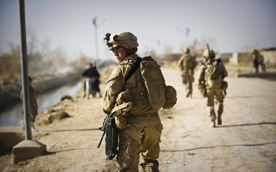 Marines assigned to 3rd Battalion, 9th Marines, patrol the streets of Marjah, Afghanistan, Dec. 17, 2010.