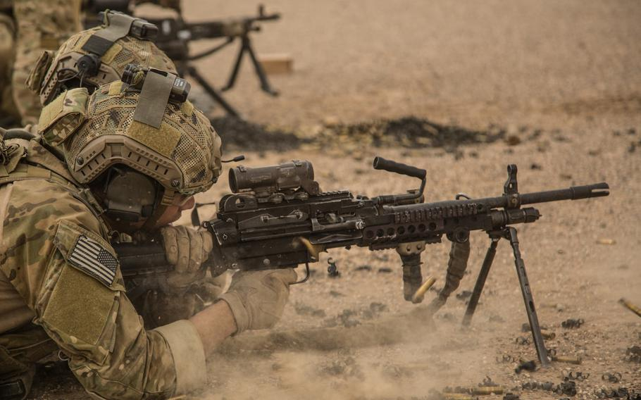 A coalition force member shoots a M-240 Bravo machine gun at a range in Helmand province, Afghanistan, Aug. 16, 2013.