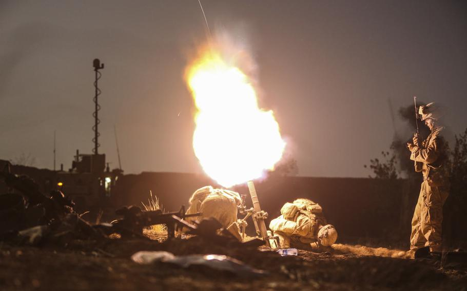 U.S. Marines with Charlie Company, 1st Battalion, 2d Marine Regiment, launch illumination rounds from a 61 mm mortar system during a night security patrol in Helmand province, Afghanistan, Sept. 11, 2014.