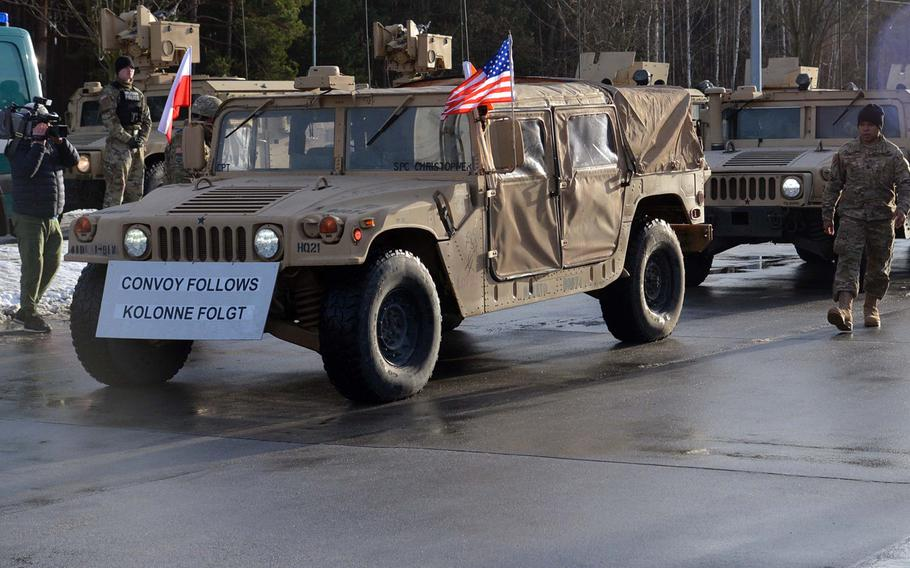 A Humvee of the 3rd Armored Brigade Combat Team, 4th Infantry Division, flies the Polish and American flags after crossing the German-Polish border near Olszyna, on its way to Zagan, Poland, Thursday, Jan. 12, 2017.