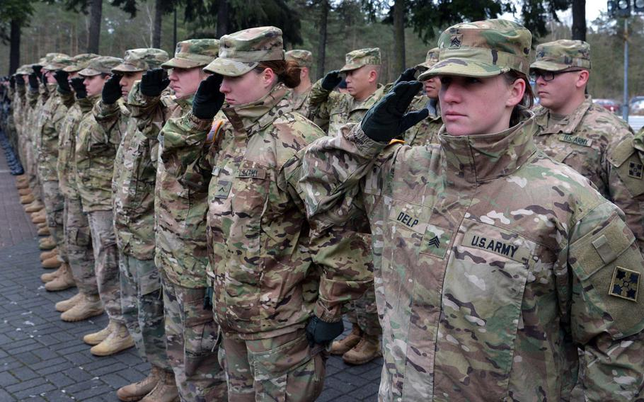 American soldiers of 3rd Armored Brigade Combat  Team, 4th Infantry Division, salute during the playing of the national anthem during a welcoming ceremony for them in Zagan, Poland, Thursday, Jan. 12, 2017.