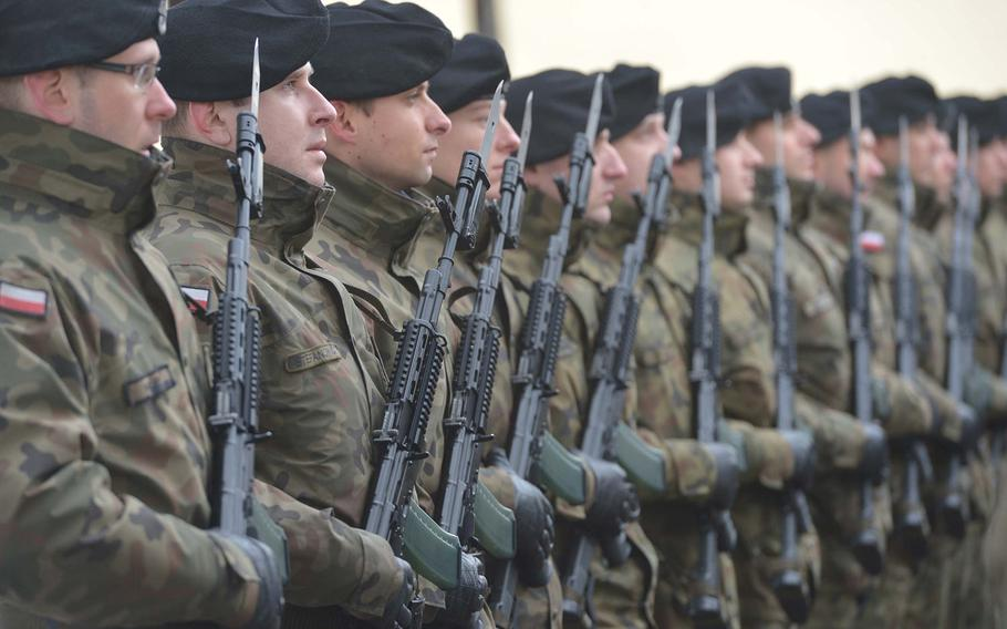 Polish soldiers stand at attention during a welcoming ceremony for the 3rd Armored Brigade Combat Team, 4th Infantry Division, in Zagan, Poland, Thursday, Jan. 12, 2017. The unit is on a nine-month deployment to eastern Europe as part of Operation Atlantic Resolve.