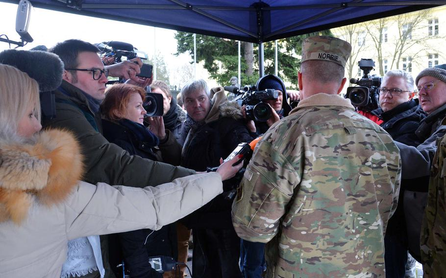 Journalists surround Col. Christopher Norrie, 3rd Armored Brigade Combat Team, 4th Infantry Division, commander, after a welcoming ceremony for his unit in Zagan, Poland. The unit is on a nine-month deployment to eastern Europe as part of Operation Atlantic Resolve.