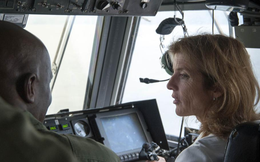 U.S. Ambassador to Japan Caroline Kennedy pilots Naval Beach Unit 7's Landing Craft, Air Cushion during an October visit to Sasebo, Japan.