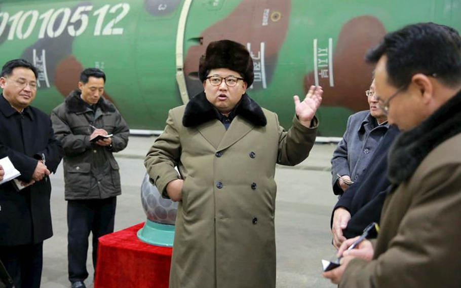 North Korean leader Kim Jong Un, center, is pictured in this undated photo from the state-run Korean Central News Agency.