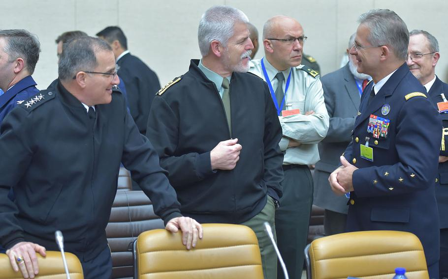 Gen. Curtis Scaparrotti, Supreme Allied Commander Europe, left; Czech Gen. Petr Pavel, chairman of the NATO Military Committee; and French Gen. Denis Mercier, Supreme Allied Commander Transformation, speak at NATO headquarters in Brussels, Tuesday, Jan. 17, 2017.
