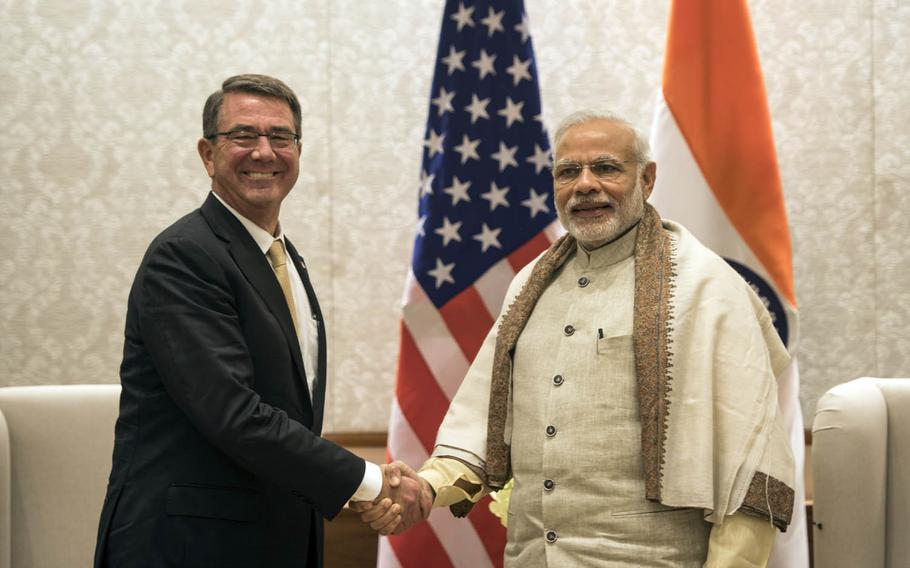 """Secretary of Defense Ash Carter poses with India's Prime Minister Narendra Modi last month in New Delhi, India. Carter called India a """"major defense partner"""" during the meeting."""