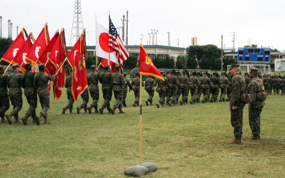 Marines from the nation's only forward-deployed Marine division march past in salute of their outgoing and incoming commanders during a change-of-command ceremony at Camp Courtney, Okinawa, Friday, Jan. 20, 2017. Maj. Gen. Richard Simcock II passed command of the 3rd Marine Division to Maj. Gen. Craig Timberlake.