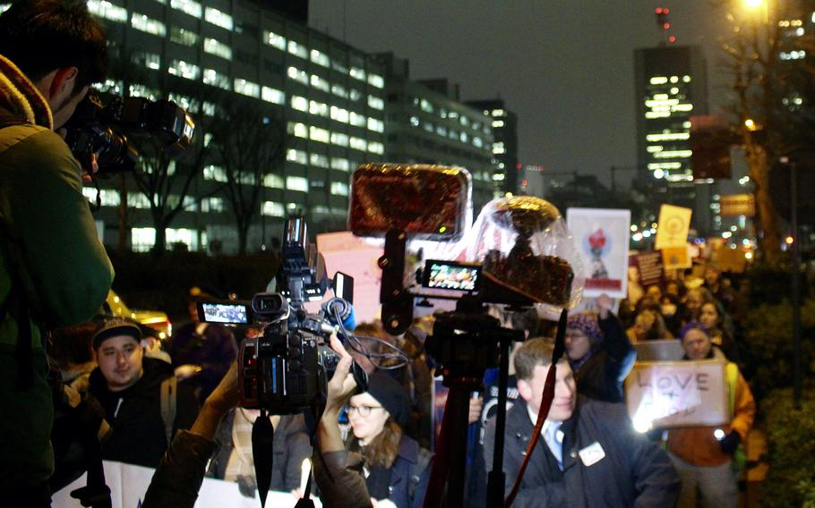 Japanese media surround the participants in the Women's March in central Tokyo on Jan. 20, 2017.