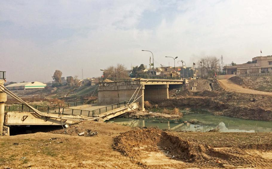 A damaged bridge over the Khoser River in Mosul, Iraq,  Saturday, Jan. 21, 2017. The area was liberated in a surprise night operation by Iraqi Special Forces last week.