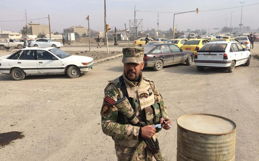 An Iraqi special forces soldier guards an intersection in Mosul, Iraq, on Saturday, Jan. 21, 2017.