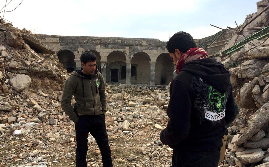 """Iraqi special forces troops at the ruins of the recently liberated Nabi Yunus Mosque, also known as the """"Tomb of Jonah,"""" in Mosul, Iraq, on Saturday, Jan. 21, 2017. The mosque was blown up by Islamic State militants."""