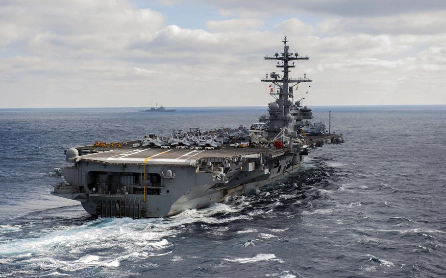 The aircraft carrier USS George H.W. Bush sails through the Atlantic Ocean, Dec. 8, 2016.  Bush's strike group deployed on Saturday, Jan. 21, 2017, to the 5th Fleet and 6th Fleet areas of operations to support the air campaign against the Islamic State group.