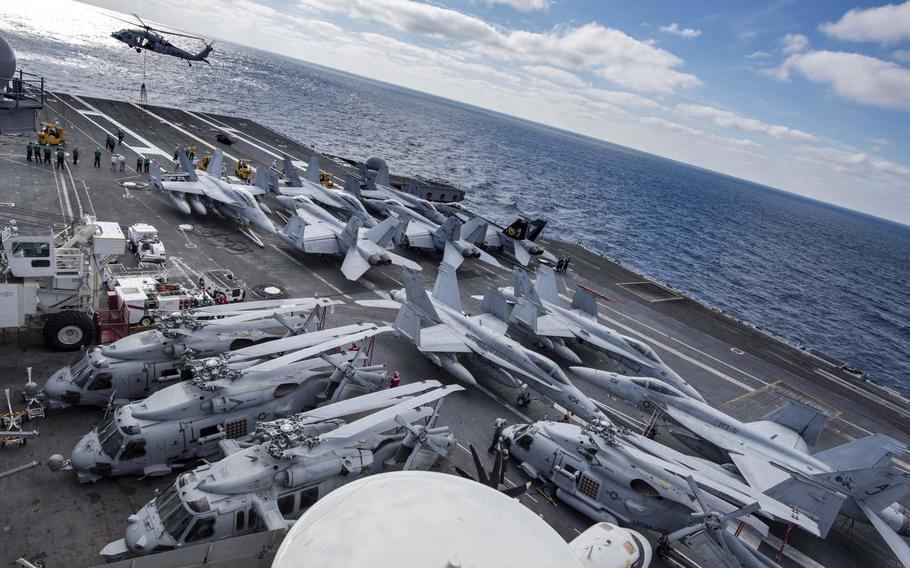 Aircraft are staged on the flight deck of the aircraft carrier USS George H.W. Bush, Dec. 8, 2016. The George H.W. Bush Carrier Strike Group deployed on Saturday, Jan. 21, 2017, to the 5th Fleet and 6th Fleet area of operations to support the campaign against the Islamic State group.
