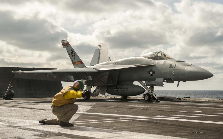 """An F/A-18E Super Hornet attached to the """"Golden Warriors"""" of Strike Fighter Squadron 87 prepares to launch from the flight deck of the aircraft carrier USS George H.W. Bush, Dec. 3, 2016. Bush deployed on Saturday, Jan. 21, 2017, to the 5th and 6th fleet areas of operations to support the air campaign against the Islamic State group."""
