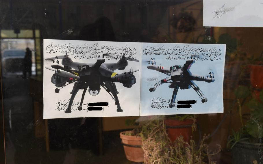 Two flyers at an Afghan Air Force base in Kabul warn troops that hobby-style quadcopters could be armed and tells them to notify base security immediately if they ever see one in the air, Jan. 16, 2017. The phone numbers have been blacked out.