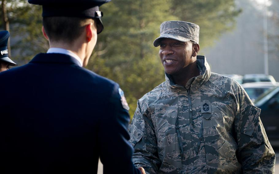 Chief Master Sgt. Kaleth Wright, U.S. Air Forces in Europe and Africa command chief master sergeant, shakes hands with an Air Force Junior Reserve Officer Training cadet at Ramstein Air Base, Germany, on Monday, Jan. 23, 2017.