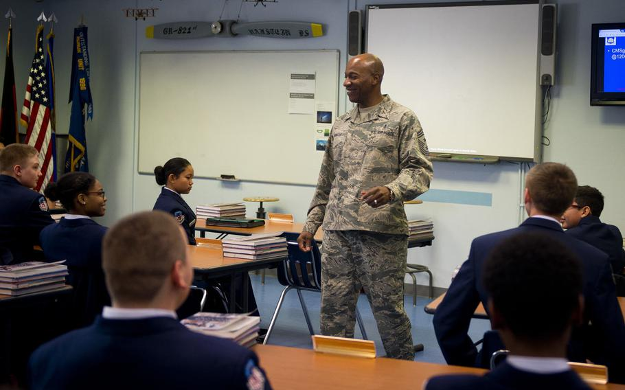 Chief Master Sgt. Kaleth Wright, U.S. Air Forces in Europe and Africa command chief master sergeant, speaks with Ramstein High School Air Force Junior Reserve Officer Training cadets at Ramstein Air Base, Germany, on Monday, Jan. 23, 2017.