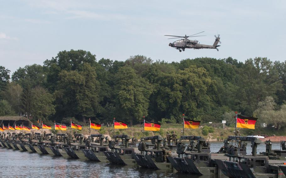 An AH-64 Apache helicopter soars over a newly constructed bridge over the Vistula River near Torun, Poland, in June 2016. Like many NATO countries, Germany has found it difficult to attain the alliance's defense budget goal of 2 percent of GDP.