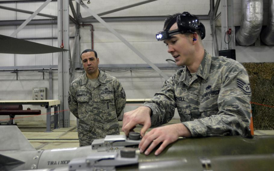 A weapons load crew team member from the 48th Maintenance Group prepares ammunition for an F-15C Eagle during the annual weapons load crew competition at RAF Lakenheath, England, Wednesday, Jan. 25, 2017.