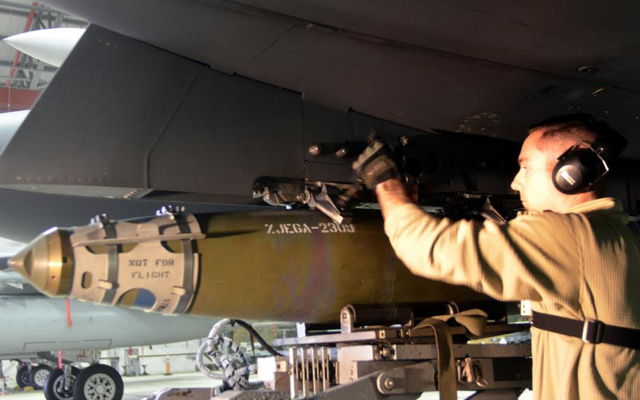 A weapons load crew team member from the 48th Maintenance Group loads ammunition onto an F-15C Eagle during the annual weapons load crew competition at RAF Lakenheath, England, Wednesday, Jan. 25, 2017.