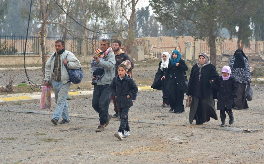 Residents return to Mosul's al-Arabi neighborhood Wednesday, Jan. 25, 2016.