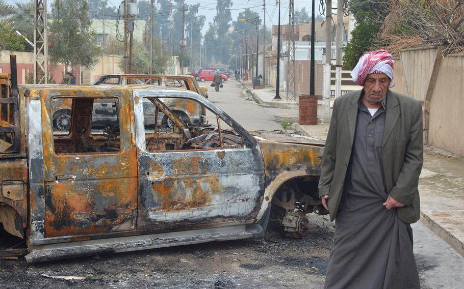 Residents of Mosul's al-Arabi neighborhood said Islamic State fighters forced them to burn their cars during a battle with Iraqi special forces troops on Jan, 20, 2017.